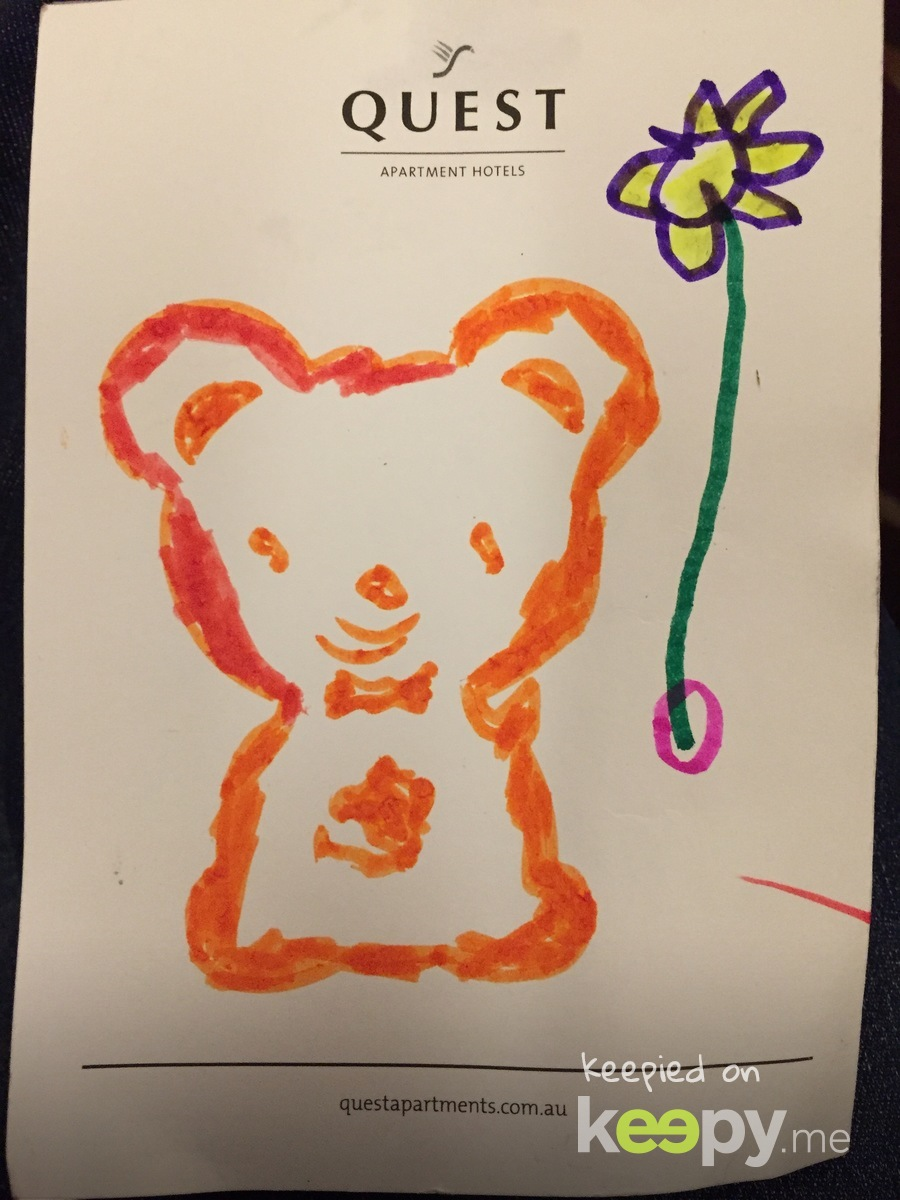 Teddy holding a flower balloon in Teddy's house. The arrow is pointing to the balloon.